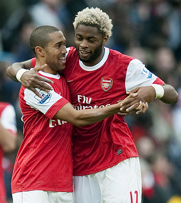Arsenal's Alex Song (right) celebrates with teammate Gael Clichy after scoring against West Ham on Saturday