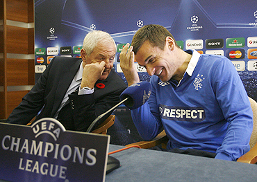 Rangers' Lee McCulloch and team manager Walter Smith (left) joke at a news conference in Valencia on Monday