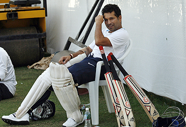 Sachin Tendulkar relaxes during a practice session in Ahmedabad on Monday