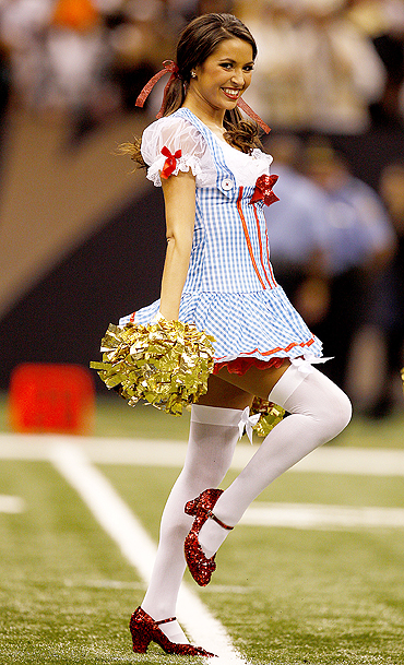 A New Orleans Saintsations dancer, dressed as the character of Dorothy Gale from the movie 'The Wizard of Oz', smiles during the New Orleans Saints NFL football game against the Pittsburgh Steelers in New Orleans, Louisiana on Sunday