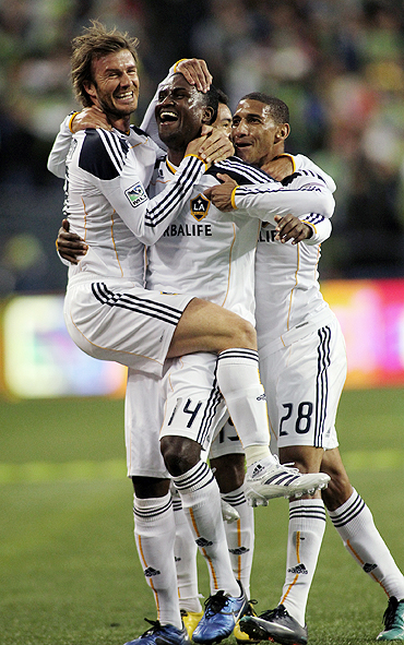Los Angeles Galaxy midfielder David Beckham (left) celebrates with Edson Buddle (centre) after the latter scored in Game 1 of their MLS Western Conference semi-finals at Qwest Field in Seattle on Sunday