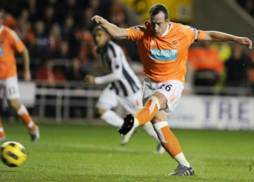 Blackpool's Charlie Adam scores from a penalty