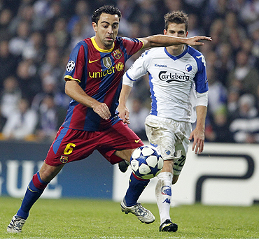Barcelona's Xavi Hernandez (left) goes past Copenhagen's Martin Vingaard during their Champions League match on Tuesday