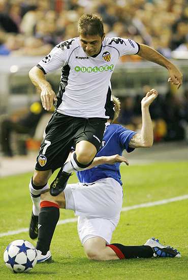 Valencia's Joaquin (foreground) is challenged by Rangers' Steven Naismith during their Champions League match on Tuesday