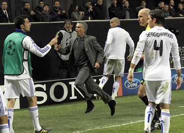 Real Madrid coach Jose Mourinho reacts after Pedro Leon scores the equalising goal against AC Milan