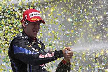 Sebastian Vettel celebrates after winning Brazil GP