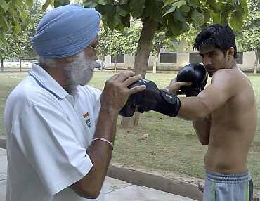 Gurbax Singh Sandhu and Vijender Singh