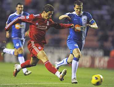Liverpool's Fernando Torres scores for Liverpool
