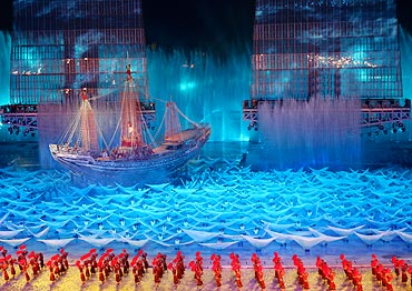 Participants perform during a rehearsal for the opening ceremony of the Asian Games in Guangzhou