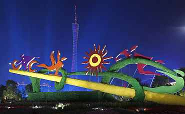 Sports sculptures are pictured in front of the Guangzhou TV Tower