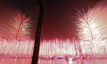 Fireworks explode at the Pearl river during the opening ceremony