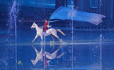 A performer is astride a horse during the opening ceremony