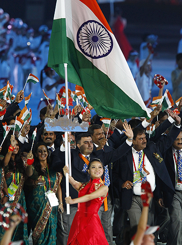 Gagan Narang leads out Indan athletes and officials during the opening ceremony