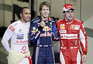 Sebastian Vettel, Fernando Alonso and Lewis Hamilton pose after the F1 qualifying race in Abu Dhabi on Saturday