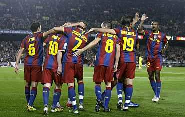 Barcelona players celebrate after scoring against Villarreal