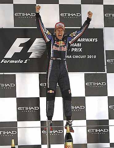 Sebastian Vettel celebrates after winning the F1 Grand Prix