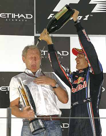 Sebastian Vettel celebrates with Red Bull Motorsport Director Helmut Marko after winning the Abu Dhabi F1 GP