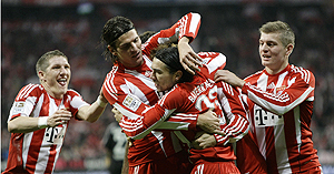 Bayern Munich players celebrate after scoring against Nuremberg on Sunday