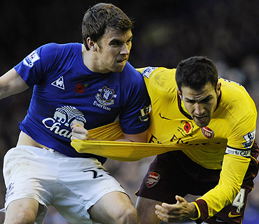 Everton's Coleman challenges Arsenal's Cesc Fabregas during their  match on Sunday