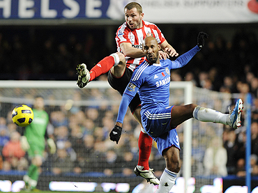 Sunderland's Phil Bardsley (left) and Chelsea's Nicolas Anelka are involved in an aerial duel during their match on Sunday