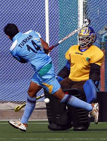 India's Tushar Khandekar tries to score against Bangladesh