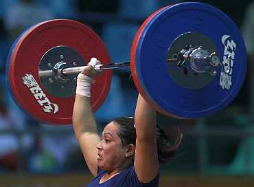 Monika Devi of India competes in the women's 69kg weightlifting competition