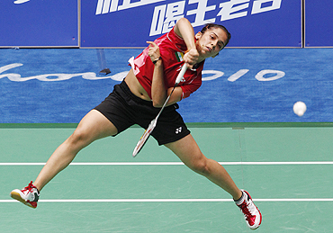 Saina Nehwal returns a shot against Hong Kong's Yip during their quarterfinal tie on Thursday