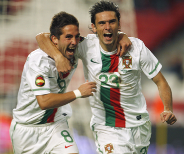 Portugal's Helder Postiga (R) celebrates his goal with his teammate Joao Moutinho during an international soccer friendly match against Spain at Luz stadium in Lisbon