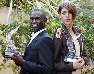 Rudisha and Vlasic with their trophies