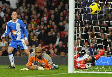 Manchester United's Patrice Evra scores against Wigan Athletic