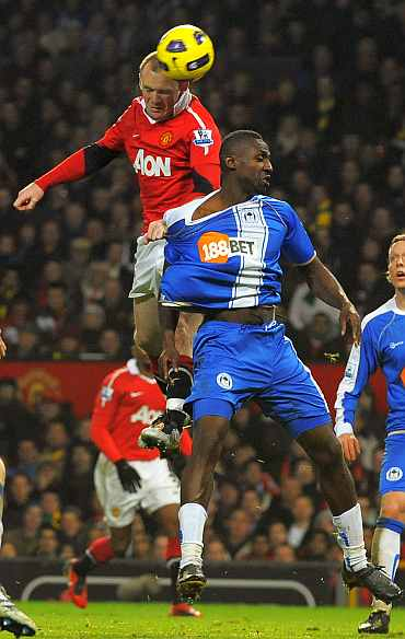 Wayne Rooney in action against Wigan Athletic