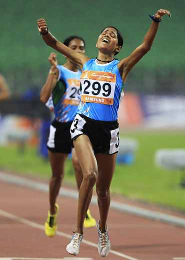 Preeja Sreedharan celebrates after winning the women's 10,000m final