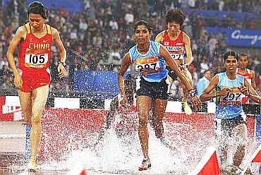 India's Sudha Singh runs during the women's 300m steeplechase at the 16th Asian Games in Guangzhou