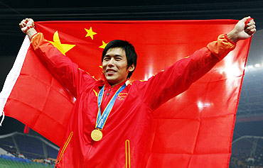 Lao Yi of China celebrates after winning the men's 100m final at the 16th Asian Games in Guangzhou