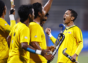 Malaysia's Mohd Amin Rahim (right) celebrates after scoring against India during their men's hockey semi-final on Tuesday