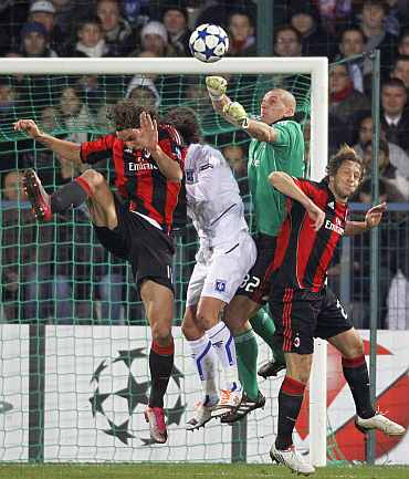 AC Milan's Goalkeeper Abbiati jumps to make a save during their match against AJ Auxerre in Auxerre