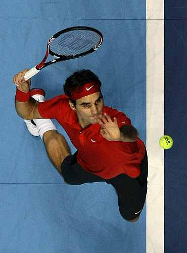 Roger Federer serves during his match against Andy Murray at the ATP World Tour Finals in London