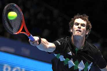 Andy Murray in action against Roger Federer during their match at the ATP World Tour Finals in London