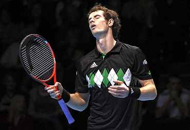 Andy Murray reacts after missing a point during the ATP World Tour Finals in London