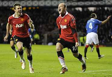 Wayne Rooney celebrates after scoring against Rangers