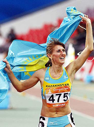 Kazakhstan's Margarita Matsko celebrates winning the women's 800m final at the 16th Asian Games in Guangzhou