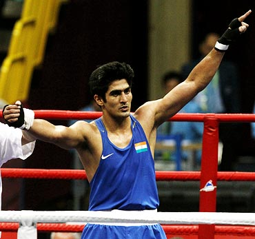 Vijender Singh wins the gold medal in the men's 75kg boxing event at the 16th Asian Games