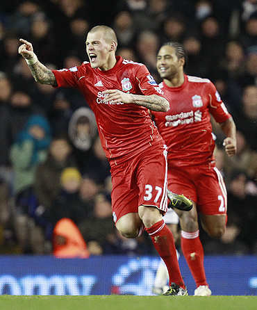 Liverpool's Martin Skrtel (left) celebrates after netting against Tottenham Hotspurs on Sunday