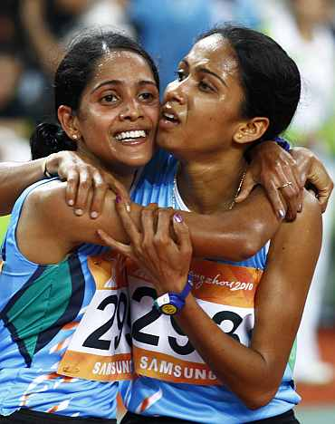 Preeja Sreedharan celebrates after winning the women's 10,000m final with Kavita Raut