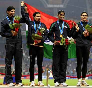 India's women's 4x400m relay team stand with their gold medals