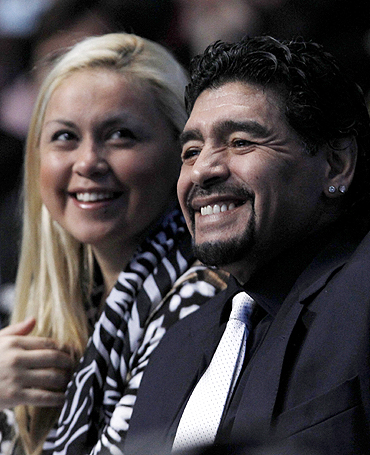 Former Argentine soccer star Diego Maradona and girlfriend Veronica Ojeda watch the finals between Rafael Nadal and Roger Federer at the ATP World Tour Finals in London on Sunday