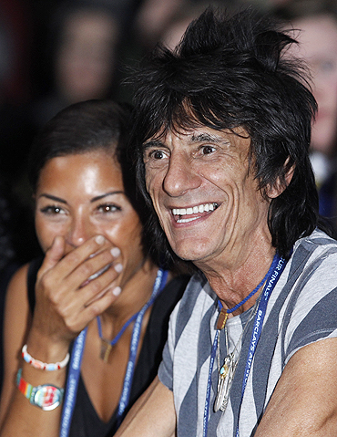 Member of the Rolling Stones Ron Wood (right) and girlfriend Ana Araujo watch the finals between Rafael Nadal and Roger Federer at the ATP World Tour Finals in London on Sunday