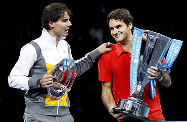 Rafael Nadal (left) congratulates Roger Federer following their final at the ATP World Tour Finals in London on Sunday