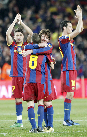Barcelona's players celebrate after defeating Real Madrid at Nou Camp on Monday
