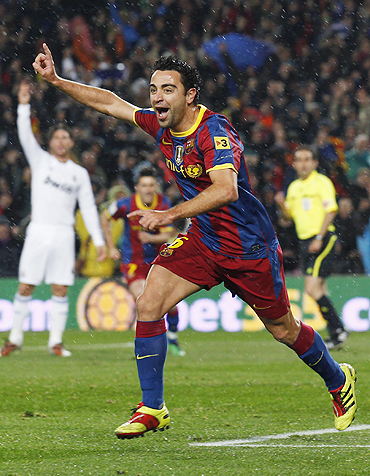 Barcelona's Xavi Hernandez celebrates after scoring the first goal against Real Madrid at Nou Camp on Monday